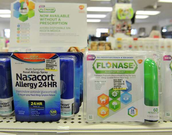 A view of Nasocort and Flonase steroid nasal sprays seen on the shelf at Marra's Pharmacy on Thursday, April 30, 2015, in Cohoes, N.Y.   The two sprays are new in the over-the-counter market this year.  (Paul Buckowski / Times Union) Photo: PAUL BUCKOWSKI / 00031657A