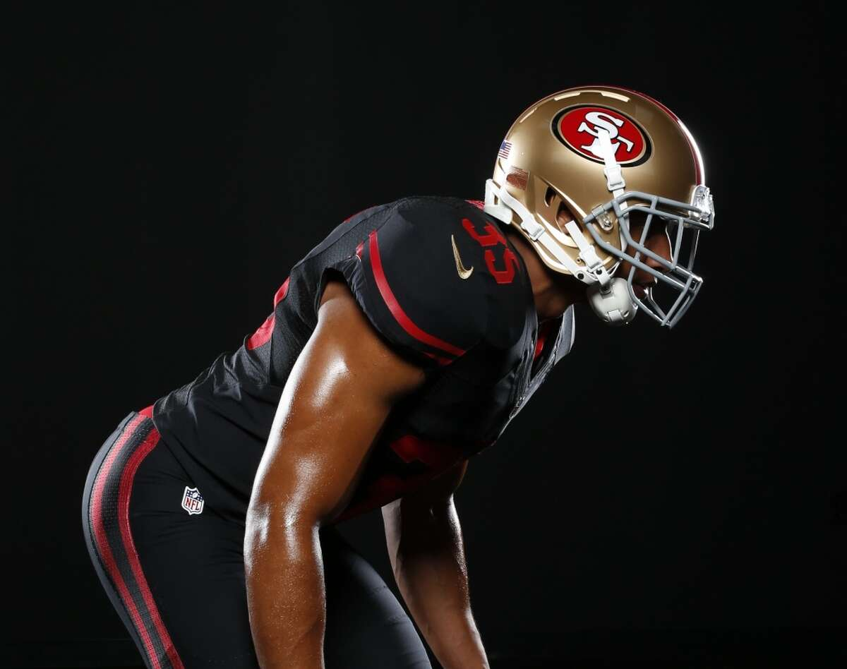 Eric Reid models the new 49ers alternate uniform.