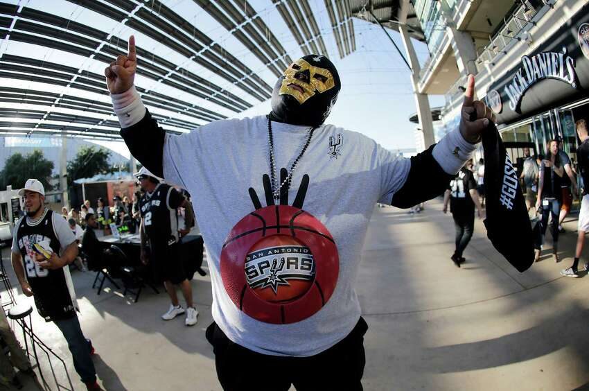 Spurs fan Arturo Alderete sports a Spurs-inspired Mexican wrestling mask among other items to support his team before Game 6 between the Spurs and the Los Angeles Clippers in the first round of the Western Conference playoffs at the AT&T Center on Thursday, Apr. 30, 2015.