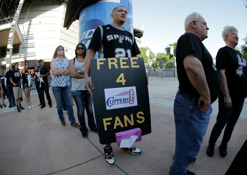 Spurs fan Juan Ramirez carries a message for Los Angeles Clippers supporters before Game 6 between the Spurs and the Clippers in the first round of the Western Conference playoffs at the AT&T Center on Thursday, Apr. 30, 2015.