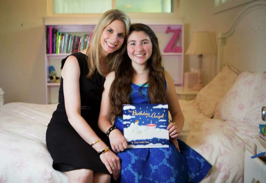 "A talk between Zoey Hess, 11, and her mother Kelly prompted her to write ""The Birthday of an Angel."" Photo: Marie D. De Jesus, Staff / © 2015 Houston Chronicle"