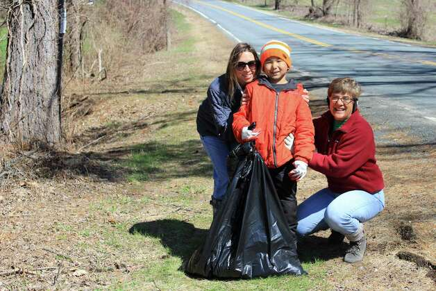 Tomahannock Clean-Up Seven-year-old John Frasier, with his mom Denise McKeon and friend Anne Bohern from Albany, picked up refuse around the Tomahannock Reservoir Clean-Up on Saturday, April 25, in honor of Earth Day. The event is sponsored by the Rensselaer Land Trust and the CIty of Troy.  Trix Niernberger