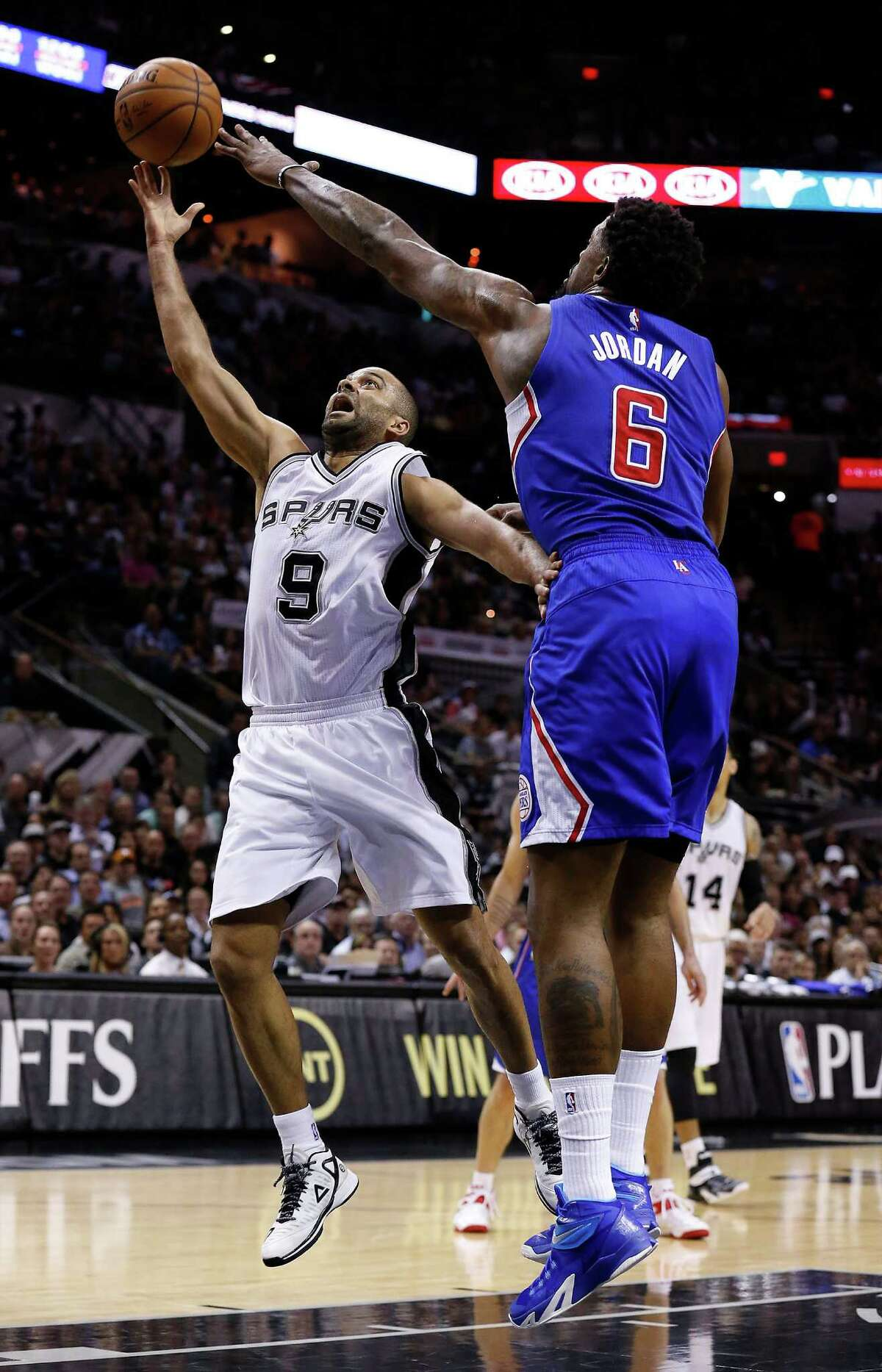 Spurs' Tony Parker (09) shoots against Los Angeles Clippers' DeAndre Jordan (06) during Game 6 of the first round of the Western Conference playoffs at the AT&T Center on Thursday, Apr. 30, 2015.