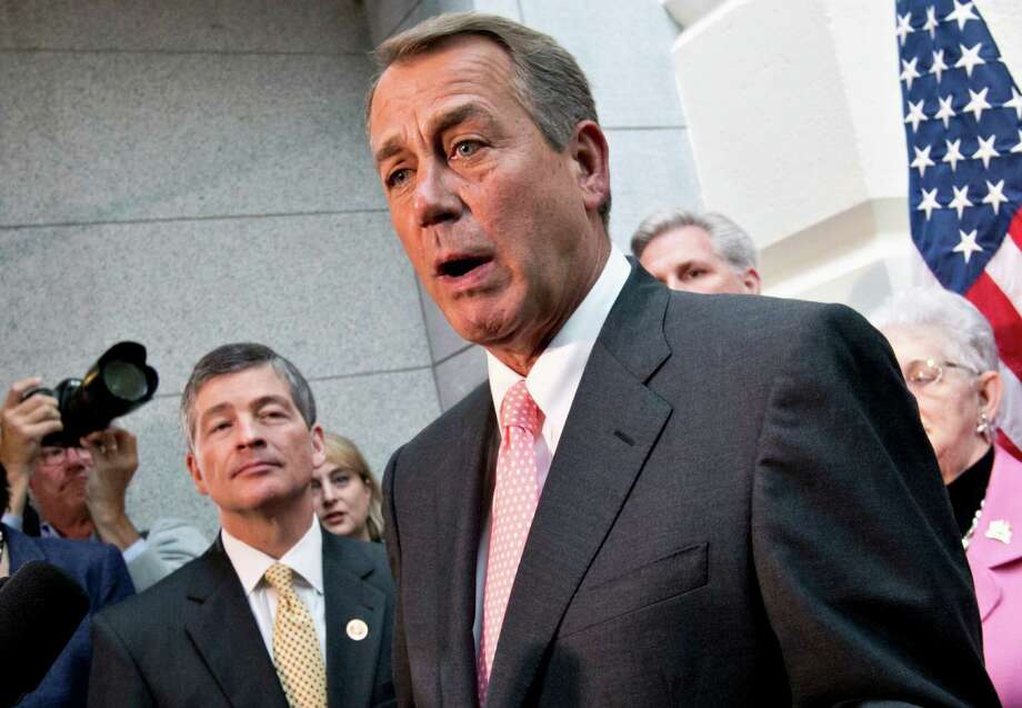 FILE - In this Oct. 10, 2013 file photo, House Financial Service Committee Chairman Rep. Jeb Hensarling, R-Texas, left, listens as House Speaker John Boehner of Ohio speaks during a news conference on Capitol Hill in Washington. (AP Photo/J. Scott Applewhite, File) Photo: J. Scott Applewhite, STF / AP