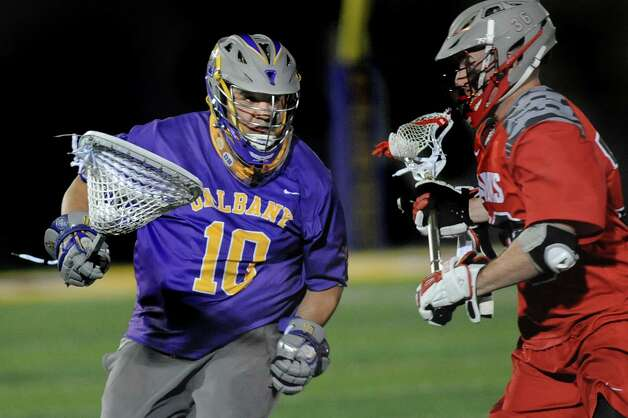 UAlbany's goal keeper Blaze Riorden, left, carries the ball as Hartford's Alec Brown defends during their Lacrosse semifinal game on Thursday, April 30, 2015, at Bob Ford Field in Albany, N.Y. (Cindy Schultz / Times Union) Photo: Cindy Schultz / 00031626A
