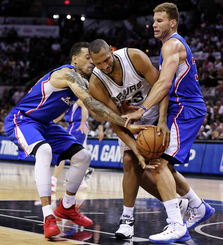 San Antonio Spurs' Boris Diaw struggles for control of the ball between Los Angeles Clippers' Matt Barnes (left) and Blake Griffin during second half action in Game 6 of the first round of the Western Conference playoffs Thursday April 30, 2015 at the AT&T Center. The Clippers won 102-96. Photo: Edward A. Ornelas, Staff / San Antonio Express-News / © 2015 San Antonio Express-News