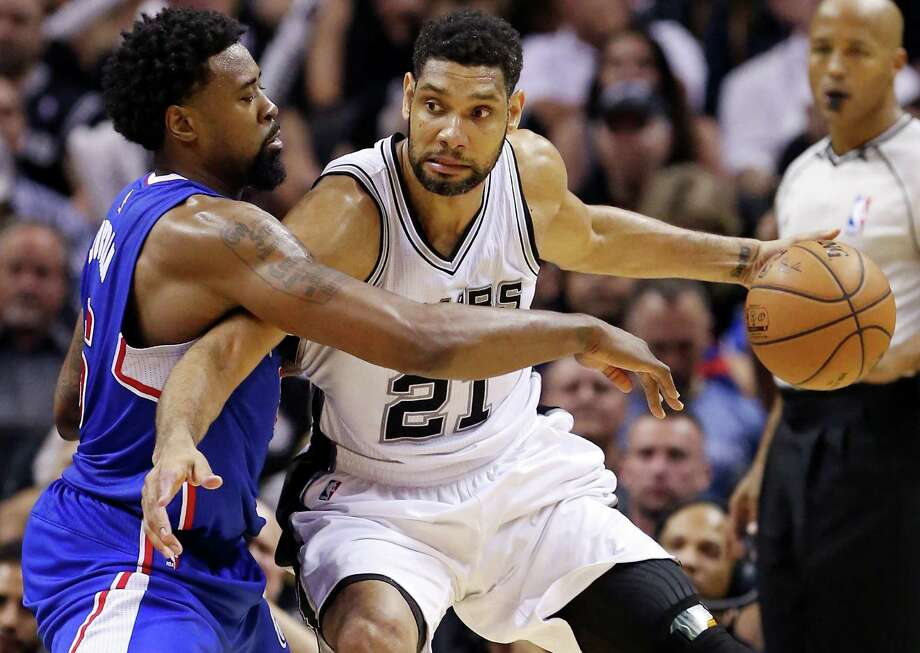 San Antonio Spurs' Tim Duncan looks for room around Los Angeles Clippers' DeAndre Jordan during first half action in Game 6 of the first round of the Western Conference playoffs on April 30, 2015 at the AT&T Center. Photo: Edward A. Ornelas /San Antonio Express-News / © 2015 San Antonio Express-News