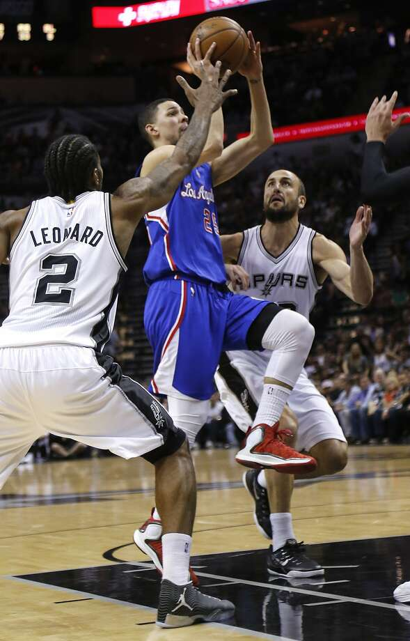 SAN ANTONIO, TX - APRIL 30: Austin Rivers #25 of the Los Angeles Clippers shoots between Kawhi Leonard #2 and Manu Ginobili #20 of the San Antonio Spurs during Game Six of the Western Conference quarterfinals of the 2015 NBA Playoffs at the AT&T Center on April 30, 2015 in San Antonio, Texas. NOTE TO USER: User expressly acknowledges and agrees that, by downloading to the terms and conditions of the Getty Images License Agreement. (Photo by Chris Covatta/Getty Images) Photo: Chris Covatta, Getty Images