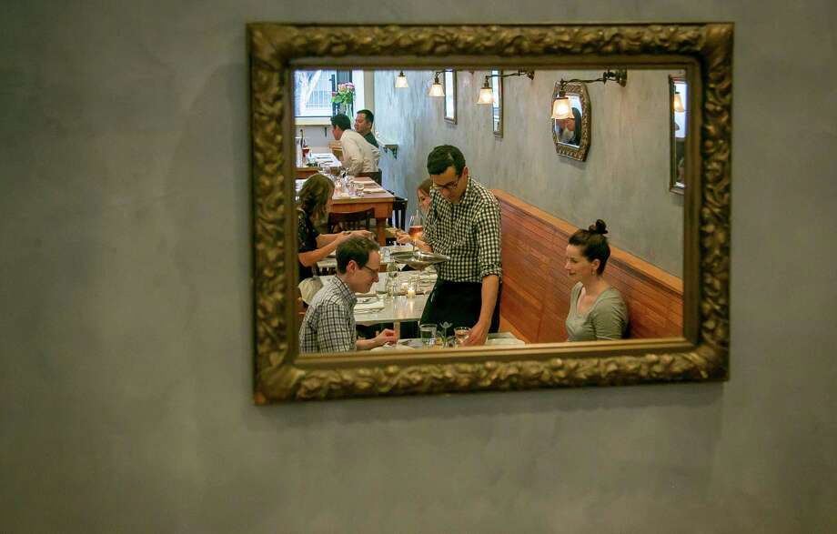 Diners at the rustic French restaurant Sous Beurre Kitchen, which stands out among the cadre of eclectic restaurants on 24th Street in the Mission. Photo: John Storey / Special To The Chronicle / ONLINE_YES