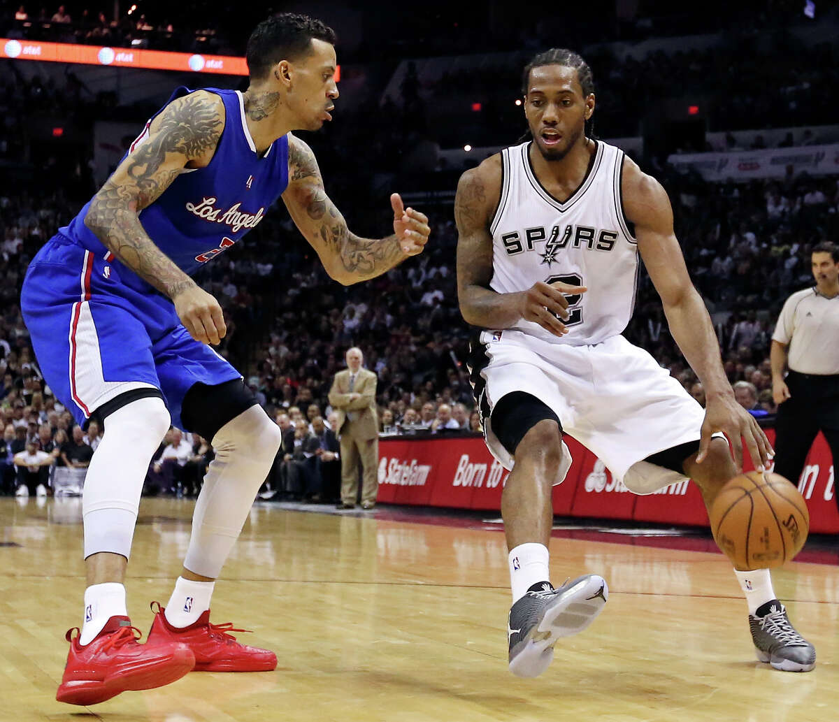 Spurs' Kawhi Leonard looks for room around Los Angeles Clippers' Matt Barnes during second half action in Game 6 of the first round of the Western Conference playoffs Thursday April 30, 2015 at the AT&T Center.