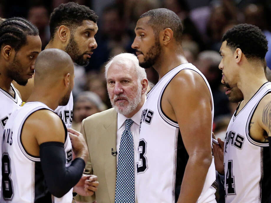 Spurs head coach Gregg Popovich (center) talks with the team during a timeout in Game 6 of the first round of the Western Conference playoffs against the Los Angeles Clippers on April 30, 2015 at the AT&T Center. Photo: Edward A. Ornelas /San Antonio Express-News / © 2015 San Antonio Express-News