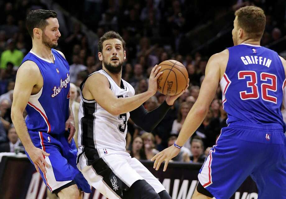 San Antonio Spurs' Marco Belinelli looks to pass between Los Angeles Clippers' J.J. Redick (left) and Blake Griffin during second half action in Game 6 of the first round of the Western Conference playoffs on April 30, 2015 at the AT&T Center. The Clippers won 102-96. Photo: Edward A. Ornelas /San Antonio Express-News / © 2015 San Antonio Express-News