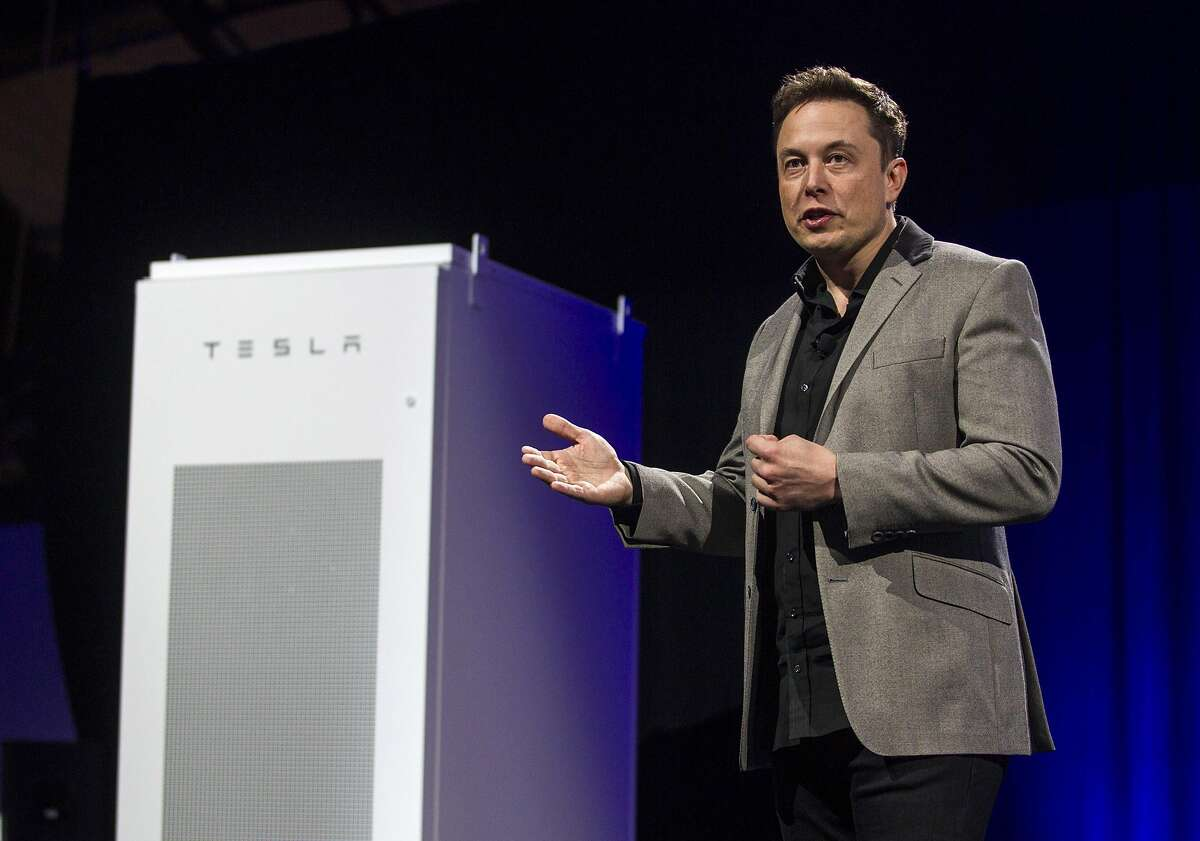 Elon Musk, CEO of Tesla Motors Inc., unveils the company's newest product, Powerpack in Hawthorne, Calif., Thursday, April 30, 2015. (AP Photo/Ringo H.W. Chiu)