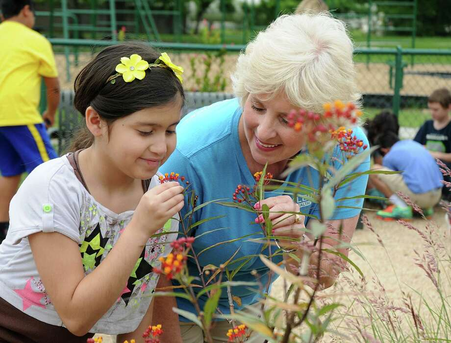 Garden Club member Fanny Amaya and school nurse Linda Rosemeyer examine a flower at the Klein ISD's Greenwood Elementary School, 12100 Misty Valley Drive in Houston, educational garden. Photograph by David Hopper. Photo: David Hopper, Freelance / freelance