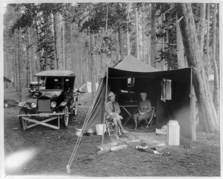 A man and woman camp at Yellowstone National Park circa 1923. Photo: Courtesy Photo /Washington Post / THE WASHINGTON POST