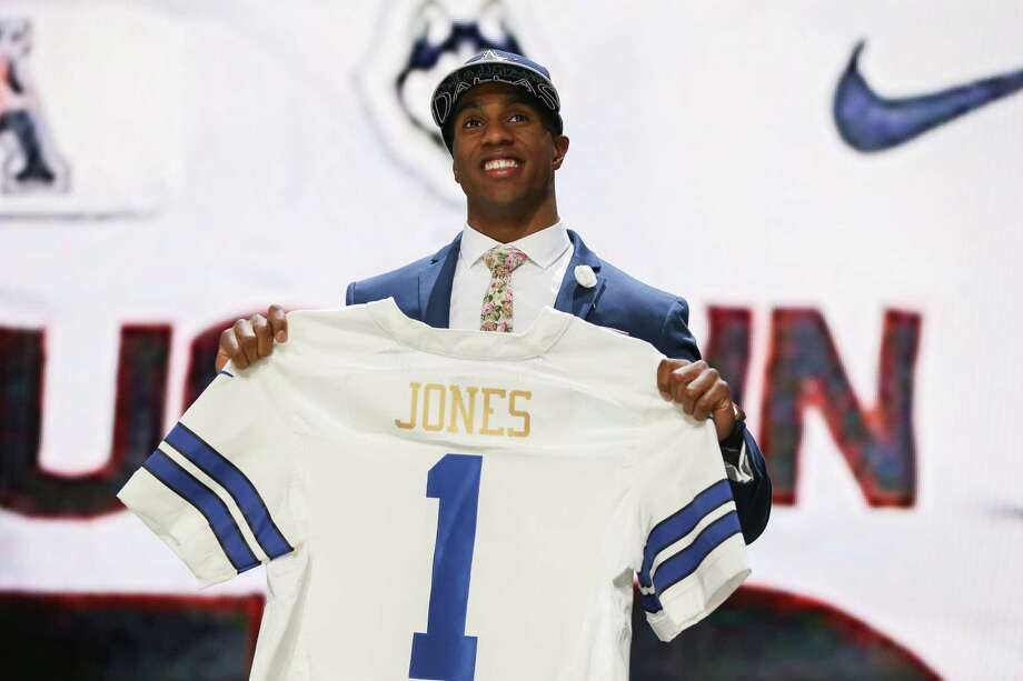 Byron Jones of the Connecticut Huskies holds up a jersey after being picked #27 overall by the Dallas Cowboys during the first round of the 2015 NFL draft at the Auditorium Theatre of Roosevelt University on April 30, 2015 in Chicago, Illinois. Photo: Jonathan Daniel /Getty Images / 2015 Getty Images
