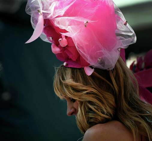 A woman wears the colors of the day Friday morning May 1, 2015 at Churchill Downs in Louisville, KY.  It's Kentucky Oaks Day and pink is widely worn in honor of cancer survivors.       (Skip Dickstein/Times Union) Photo: SKIP DICKSTEIN