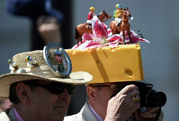 Jim Leuenberger of Green Bay, Wisc. wears pink flowers and horses on his chunk of cheese hat Friday morning May 1, 2015 at Churchill Downs in Louisville, KY.  It's Kentucky Oaks Day and pink is widely worn in honor of cancer survivors.       (Skip Dickstein/Times Union) Photo: SKIP DICKSTEIN