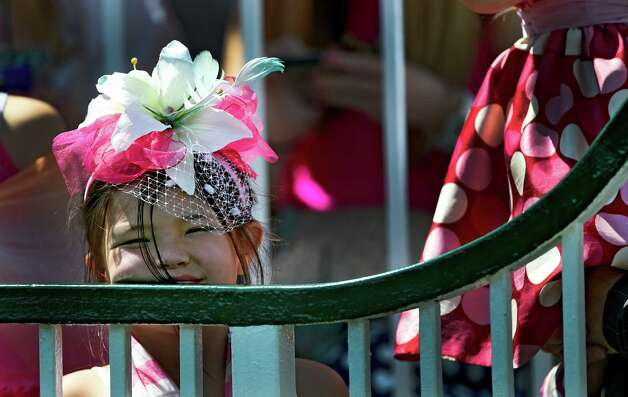 A young woman wears the colors of the day Friday morning May 1, 2015 at Churchill Downs in Louisville, KY.  It's Kentucky Oaks Day and pink is widely worn in honor of cancer survivors.       (Skip Dickstein/Times Union) Photo: SKIP DICKSTEIN