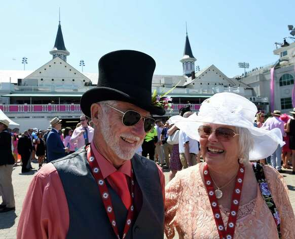 Ron and Neannie Gallagher of Los Molinos CA. enjoy the beautiful weather Friday morning May 1, 2015 at Churchill Downs in Louisville, KY.      (Skip Dickstein/Times Union) Photo: SKIP DICKSTEIN