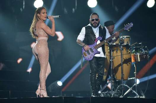MIAMI, FL - APRIL 30:  Jennifer Lopez and Los Dinos onstage after performing musical tribute to Selena at the 2015 Billboard Latin Music Awards presented bu State Farm on Telemundo at Bank United Center on April 30, 2015 in Miami, Florida. Photo: Rodrigo Varela, Getty Images / 2015 Getty Images