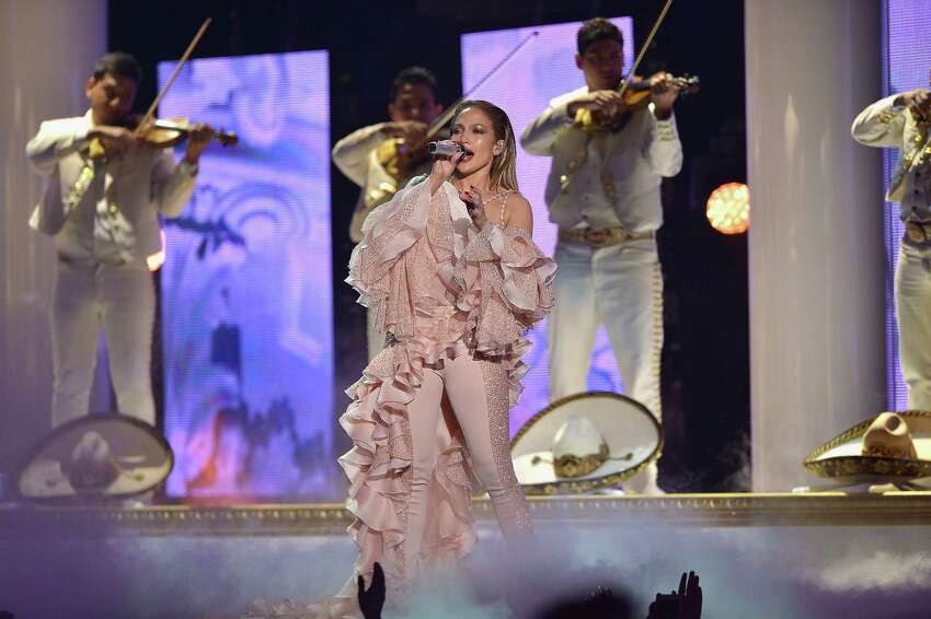 Jennifer Lopez performs musical tribute to Selena while performing with Los Dinos onstage at the 2015 Billboard Latin Music Awards presented bu State Farm on Telemundo at Bank United Center on April 30, 2015 in Miami, Florida.