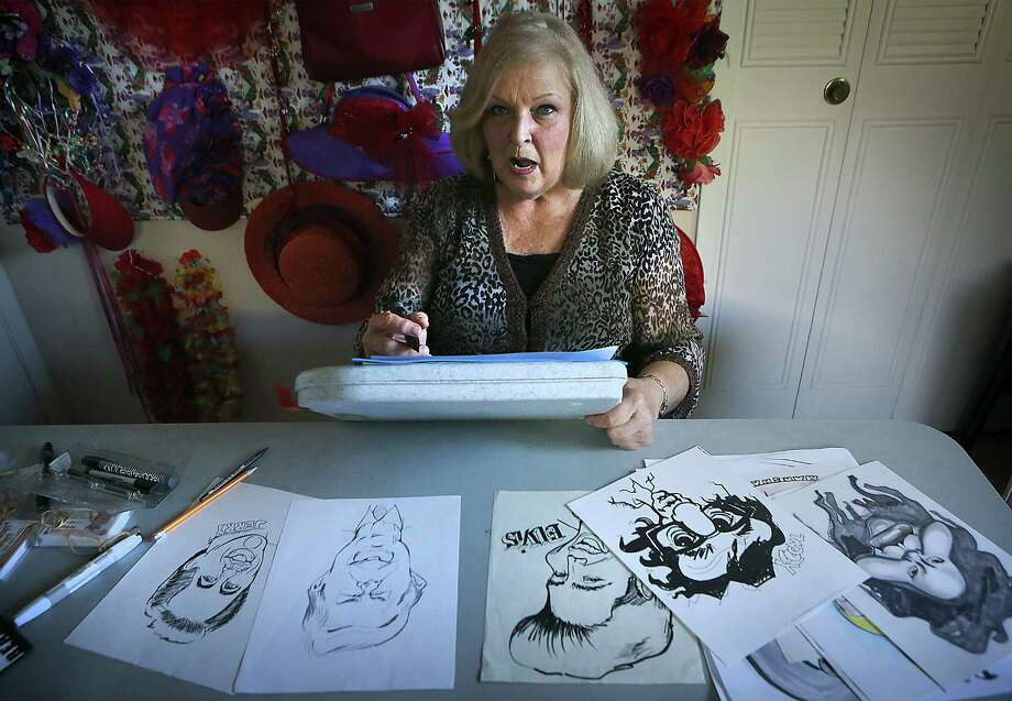 Marsha Hendricks, a former federal government employee, is a caricature artist, face painter and founder of Creative Concepts, which provides entertainment for children's parties and other special events. When drawing a subject, she stares at their face, studying the lines, curves and shadows.  Wednesday, April 29, 2015. Photo: Bob Owen, Staff / San Antonio Express-News / San Antonio Express-News