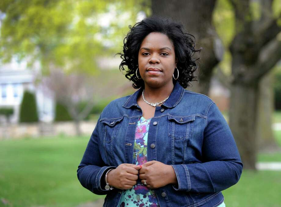Merisa Williams, 34, of Bridgeport, Conn., is photographed in Danbury Friday, May 1, 2015, where she works at Western Connecticut State University. Williams was laid off by Gov. John Rowland in 2003 and is one of thousands of state employees who will share in a multi-million dollar settlement. Photo: Carol Kaliff / The News-Times