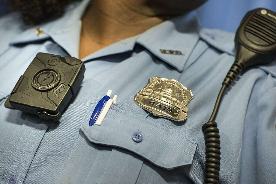 A police officer models a body camera before a press conference at City Hall in Washington, D.C. Photo: Brendan Smialowski, AFP / Getty Images