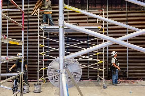Constructions crews work to finish the new American Conservatory Theater which officially opens on May 14 on Market Street in San Francisco, Thursday, April 30, 2015. Here a black box theater upstairs.