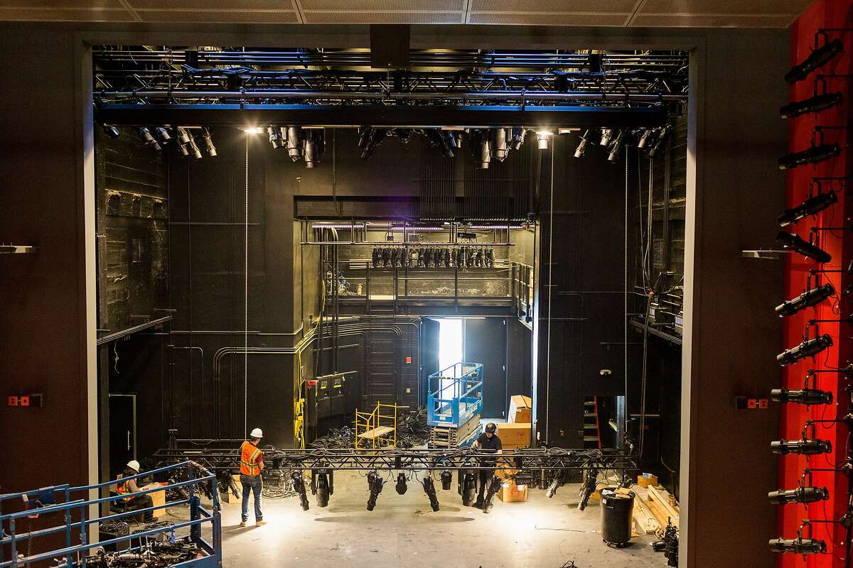 Constructions crews work to finish the new American Conservatory Theater which officially opens on May 14 on Market Street in San Francisco, Thursday, April 30, 2015. Here crews work to hang stage lighting.