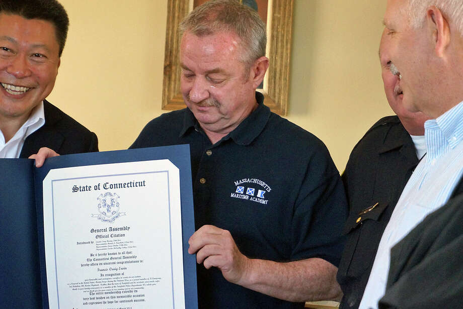 """Retired Fairfield Police Officer Francis """"Craig"""" Ervin shows off the citation he received honoring his service in the U.s. Marine Corps during the Vietnam war. Photo: Genevieve Reilly / Fairfield Citizen"""