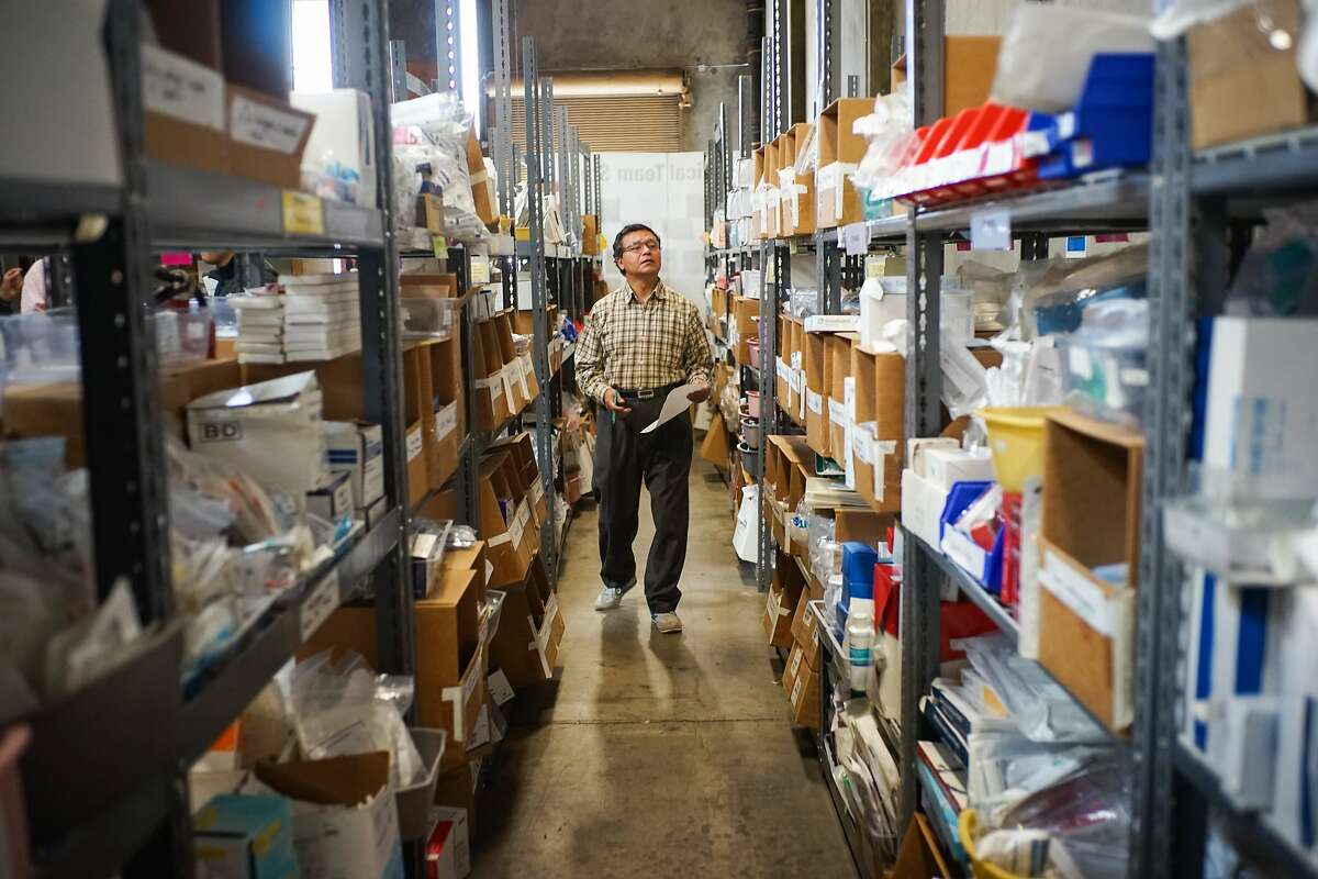Raj Kumar Shrestha of Sahayeta looks at medical supplies at MedShare in San Leandro, Calif. on Friday, May 1, 2015. MedShare has medical supplies ready for delivery to Nepal but are being delayed by air travel.