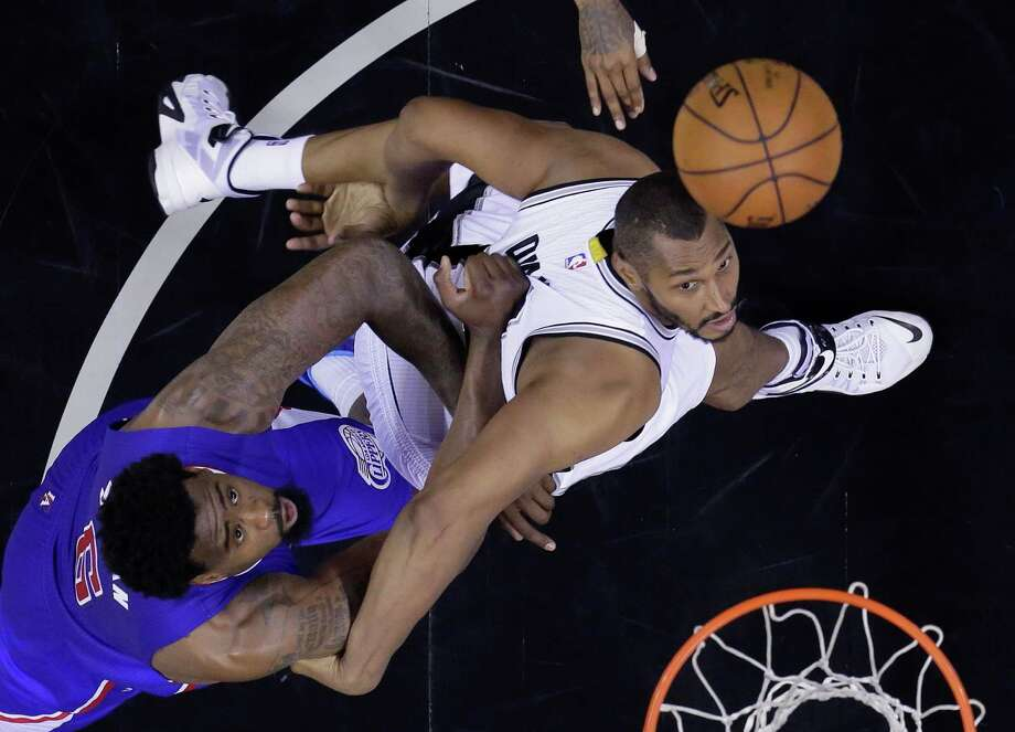 Los Angeles Clippers' DeAndre Jordan, left, and San Antonio Spurs' Boris Diaw, right, battle for a rebound during the second half of Game 6 in an NBA first-round playoff series on May 1, 2015, in San Antonio. Los Angeles won 102-96. Photo: Darren Abate /Associated Press / FR115 AP