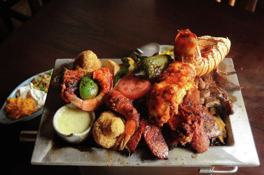 The parrilladas deluxe at new El Tiempo restaurant at 322 Wertheimer Thursday April 16, 2015.(Dave Rossman photo) Photo: Dave Rossman, Freelance / Freelalnce