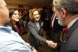 Former Hewlett-Packard CEO Carly Fiorina, shakes hands as she arrives for a business luncheon at the Barley House with New Hampshire Republican lawmakers, Tuesday, April 28, 2015, in Concord, N.H. (AP Photo/Jim Cole)