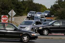 Dangerous merging:  The merge onto northbound El Camino Real from highway 92 has to wait until traffic clears Thursday February 12, 2015. Several Bay Area freeway onramps are notoriously difficult and dangerous to navigate.