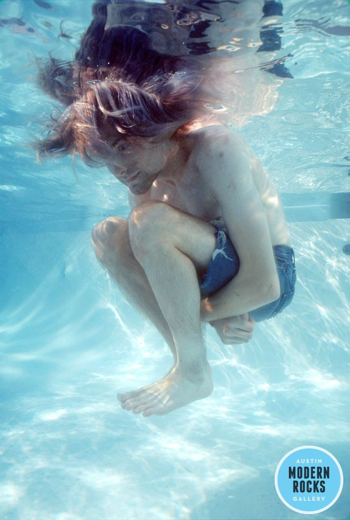 Nirvana frontman Kurt Cobain underwater in a Los Angeles motel pool for a