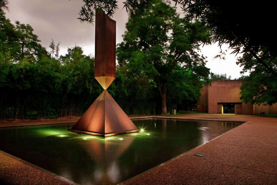 "At night, over Rothko Chapel's reflecting pond, ""Broken Obelisk"" looks particularly dramatic. (For more photos, scroll through the gallery.) Photo: J. Griffis Smith / handout"