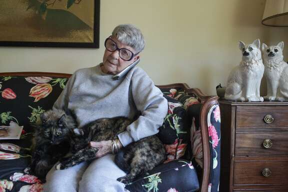 5/1/15 San Francisco, California  Vicky Berol is making arrangements for her three sister cats, Mary, Margo and Martha, to be cared for after her death. SheÕs setting up this trust through the SF SPCAÕs Sido Program. The Sido program guarantees that their pets will be adopted and not be broken up if they are bonded. The Sido program also pays for the expenses, including veterinary care for the pets.  Vicky holds Margo and Martha while chatting on the phone. She has many cat statues and figurines throughout the house.