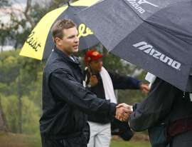 Drew Olsen (left) is congratulated after winning his match during the quarterfinal round of the 2009 San Francisco City Golf Championship at Harding Park golf course on Sunday, March 1, 2009.