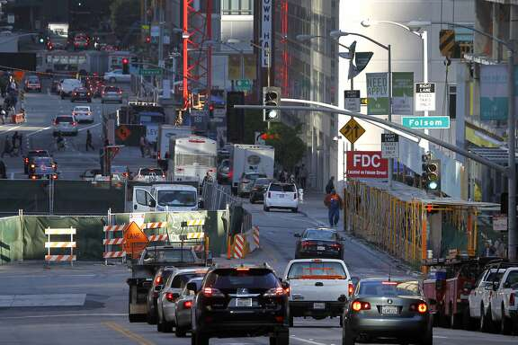 Commuters are funneled into a single lane past a construction site at Folsom and Fremont streets in downtown San Francisco, Calif. on Friday, May 1, 2015. Traffic has gotten worse due partly to numerous construction projects and the improving economy.