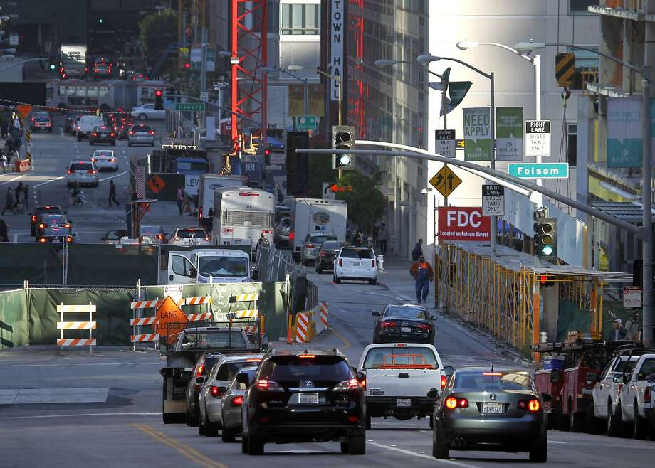 Commuters are funneled into a single lane past a construction site at Folsom and Fremont streets in downtown San Francisco, Calif. on Friday, May 1, 2015. Traffic has gotten worse due partly to numerous construction projects and the improving economy. Photo: Paul Chinn, The Chronicle