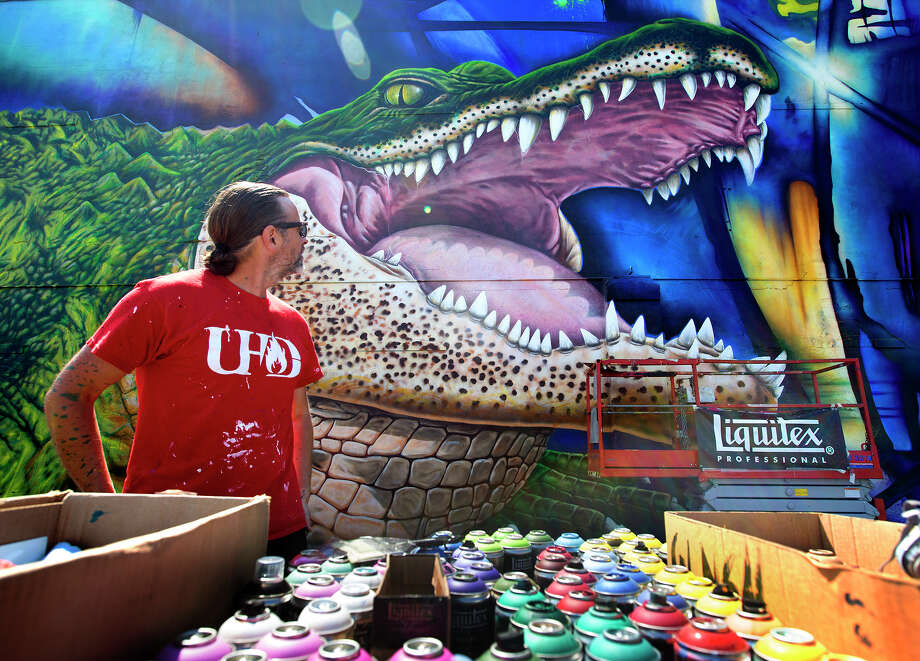 "Artist Sebastien ""Mr. D"" Boileau looks at his mural depicting, Ed-U-Gator, the University of Houston-Downtown's mascot, in 2015. The mural resided on the north side of a storage facility on campus until it was torn down for new development.  Photo: Cody Duty, Houston Chronicle / © 2015 Houston Chronicle"