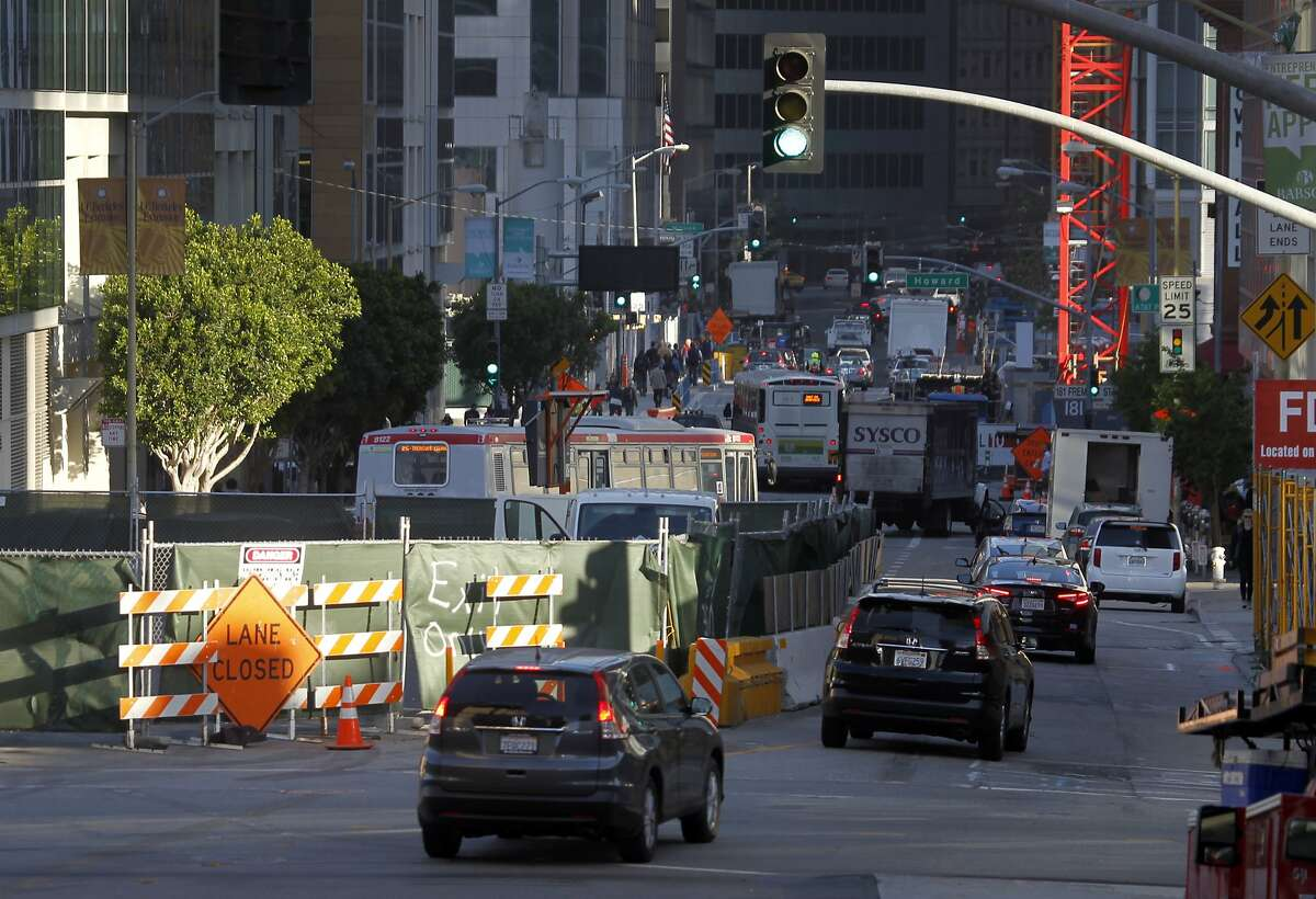 Drivers are funneled into a single lane of traffic past a construction site at Folsom and Fremont streets in downtown San Francisco, Calif. on Friday, May 1, 2015. Traffic has gotten worse due partly to numerous construction projects and the improving economy.