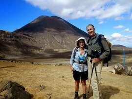 Andrea and Michael Cassidy, hiking Tongariro Crossing, passing 3 volcanoes, one of which erupted in 2011.