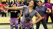 Gayatri Sumant, center, works on perfecting her hand movements during a fitness class at Bollywood Shake. The class is based on Bollywood music and culture from India with a dash of hip-hop and pop music thrown in to spice things up.