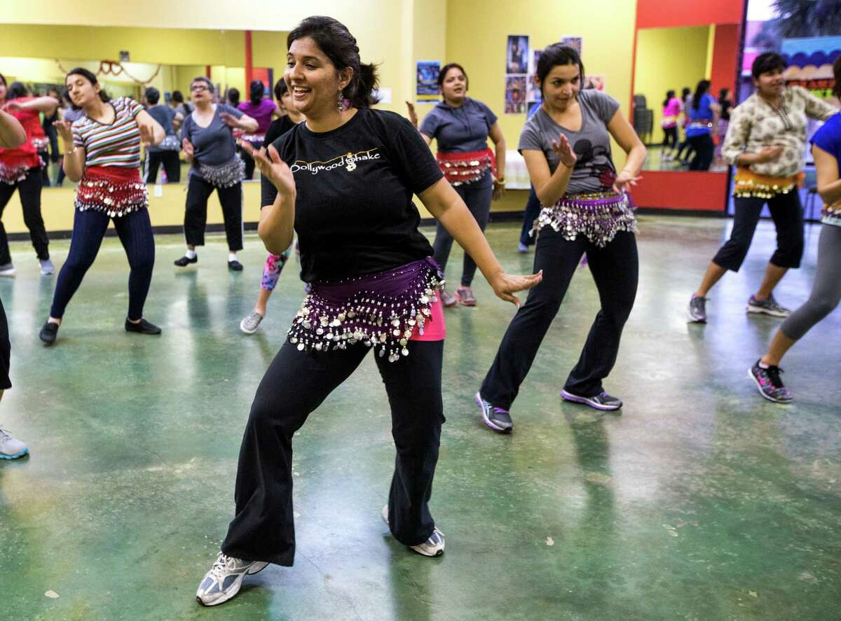 Ruchika Dias leads a dance fitness class at Bollywood Shake on Tuesday, March 24, 2015, in Houston. The class is based on Bollywood music and culture from India. ( Brett Coomer / Houston Chronicle )