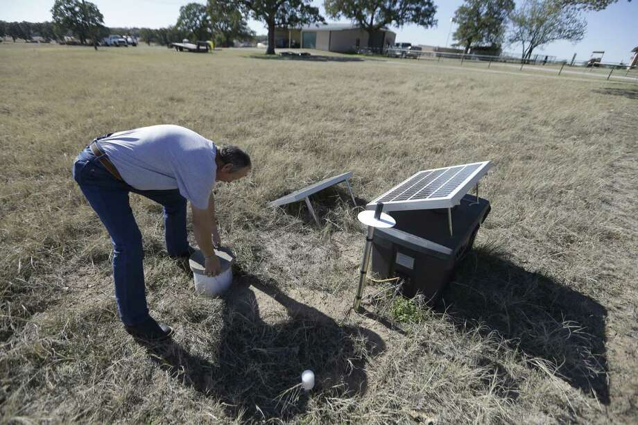 In November 2014, Director of Public Works Scott Passmore checks a solar-powered seismic monitor installed by Southern Methodist University to monitor earthquakes in Reno, Texas, a rural community surrounded by fracking. Photo: LM Otero, STF / AP
