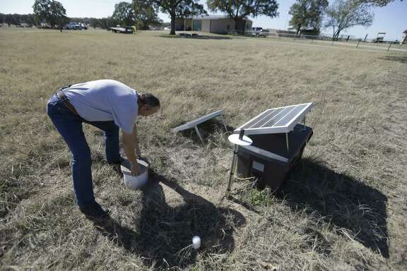 In November 2014, Director of Public Works Scott Passmore checks a solar-powered seismic monitor installed by Southern Methodist University to monitor earthquakes in Reno, Texas, a rural community surrounded by fracking.
